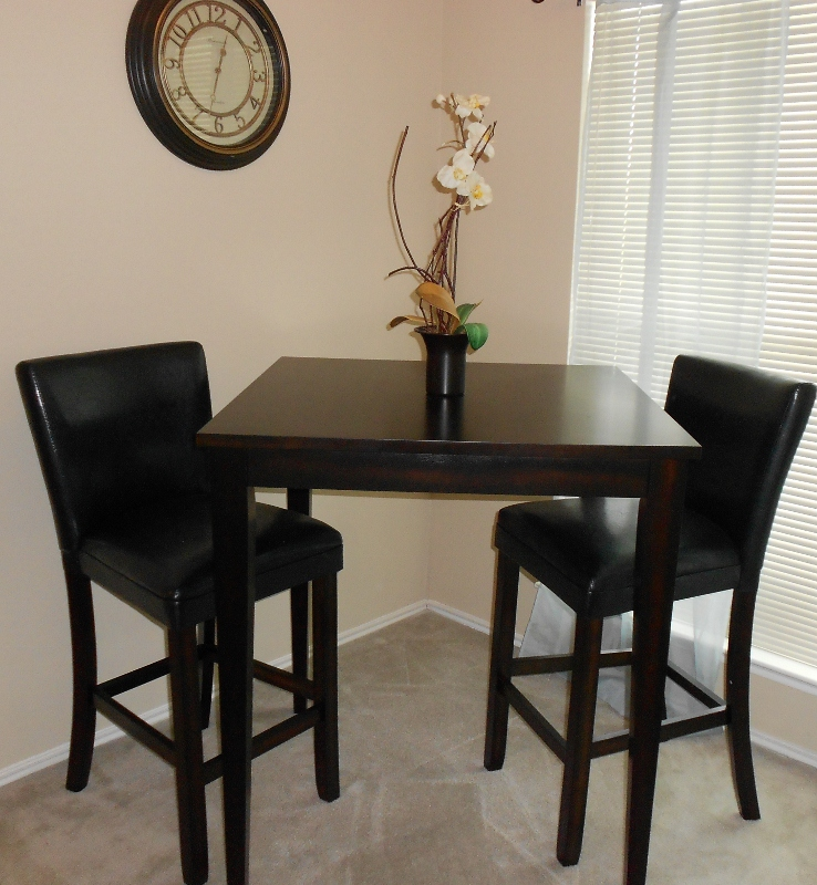 Cherry Wood Dining Table With Four Ivory Padded Chairs